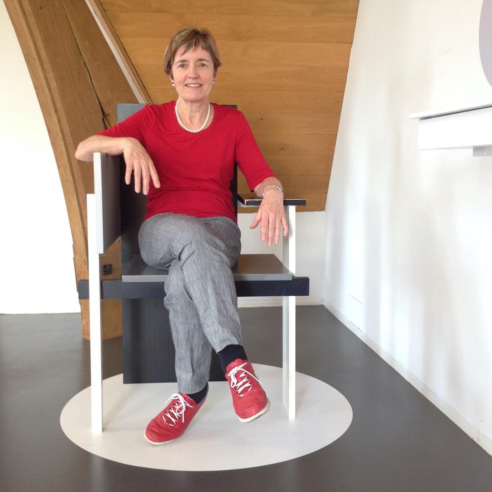 Vivien in Amsterdam on Rietveld chair